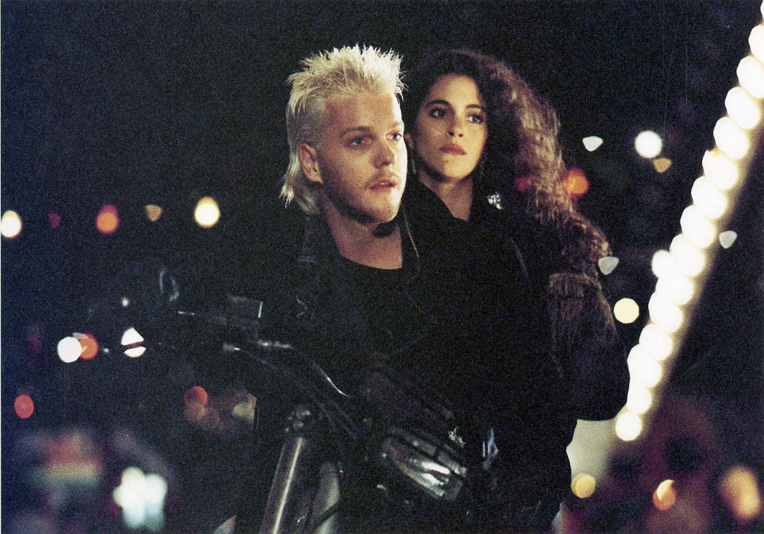 "Keifer Sutherland and Jami Gertz in the movie ""The Lost Boys""."